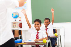 Students arms up. Elementary school students arms up in classroom royalty free stock image