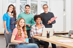 Students as a multicultural start-up team. Student group as a multicultural business start-up team in the coworking office stock photos