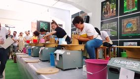 Students attending to the pottery contest at the 12th International Eskisehir Terra Cotta Symposium. Eskisehir, Turkey - September 08, 2018: Students attending stock video