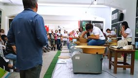 Students attending to the pottery contest at the 12th International Eskisehir Terra Cotta Symposium. Eskisehir, Turkey - September 08, 2018: Students attending stock footage