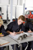 Students with auto part studying automotive trade in vocational school stock images
