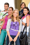Students back to school on college stairs. Teens standing smiling Royalty Free Stock Photos