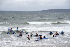 Students being taught surfing at ballybunion beach royalty free stock photos