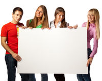 Students with blank sign Royalty Free Stock Photography