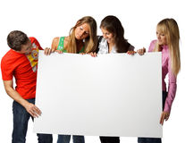 Students with blank sign Stock Photo