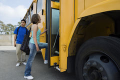 Students Boarding School Bus Stock Photo
