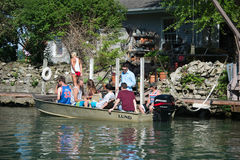 Students boating. Group of students overloading a motorboat, drinking alcohol and not wearing life jackets at Grosse Ile, Detroit on June 02, 2014 Royalty Free Stock Photos