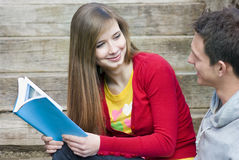 Students with book Royalty Free Stock Photos