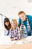 Students with books and laptop in classroom Royalty Free Stock Photo