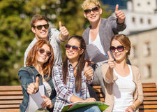 Students with books, notebooks, files and folders Stock Photos