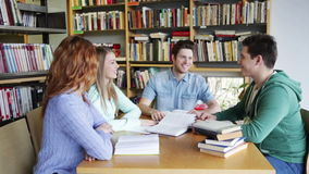 Students with books preparing to exam in library stock video footage