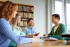 Students with books preparing to exam in library Stock Photos