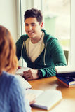 Students with books preparing to exam in library Royalty Free Stock Image
