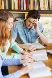 Students with books preparing to exam in library Royalty Free Stock Photo