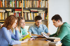 Students with books preparing to exam in library Stock Image