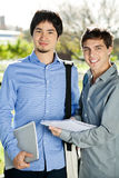 Students With Books Standing On College Campus Stock Photo