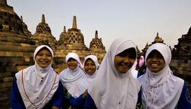 Students at the Borobodur temple in Indonesia. Schoolgirls visiting the Borobodur temple in Indonesia, the world's largest Buddhist temple in the world stock image