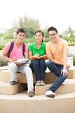 Students at break. Three lovely high school students studying outdoors Stock Images