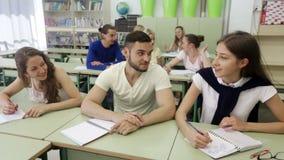 Students during break in classroom stock video