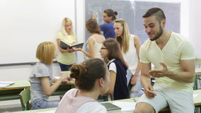 Students during break in classroom stock footage