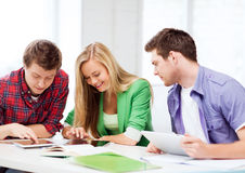 Students browsing in tablet pc at school Stock Image