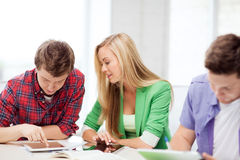 Students browsing in tablet pc at school Stock Photography