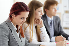 Students or businesspeople hands writing something during confer Royalty Free Stock Photos