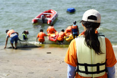 Students canoeing at seaside Stock Photo