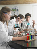 Students Caring Out Experiments In Laboratory royalty free stock images