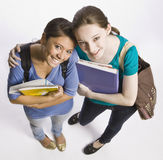 Students carrying book bag, backpack and notebooks Royalty Free Stock Photo