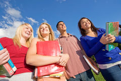 Students Carrying Books Royalty Free Stock Images