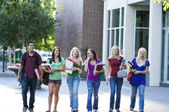 Students Carrying Books Stock Photos