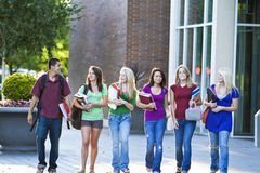 Students Carrying Books Royalty Free Stock Photos