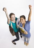 Students carrying books and cheering Royalty Free Stock Photography