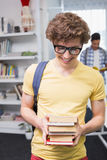 Students carrying small pile of books. At the college Royalty Free Stock Images