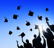 Students Celebrating Graduation Stock Photography