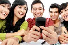 Students with cellphone Royalty Free Stock Image