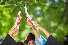 Students and certificates. Graduation: Group of Students Look to the Future royalty free stock images