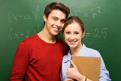 Students by chalkboard Stock Image