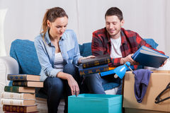 Students changing flat. Young students friends packing things to change flat Royalty Free Stock Images