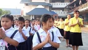 Students chanting Buddha. BANGKOK, THAILAND - FEB 9, 2015: Unknown children, Students chanting Buddha in the morning at Elementary School. bangkok at 2015 stock video footage