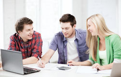 Students chatting in lecture at school Stock Photos