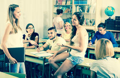 Students chatting while sitting in the room royalty free stock photos