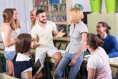 Students chatting while sitting in the room Royalty Free Stock Image
