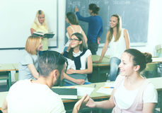 Students chatting and smiling at the college stock photo