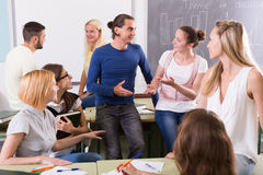 Students chatting and smiling at the college Royalty Free Stock Photography