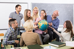 Students chatting at training session for employees during break stock image