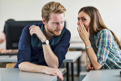 Students cheating by whispering to each other Stock Photography