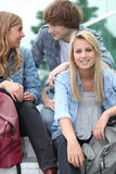 Students chilling out. Group of students gathere on the school grounds Royalty Free Stock Image