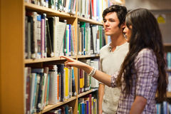 Students choosing a book Royalty Free Stock Photography